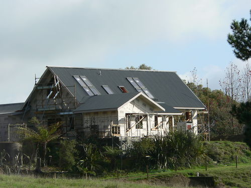 the house wrapped, the Velux windows and the roof