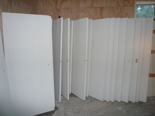 row of painted doors in garage