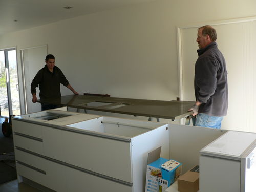 kitchen benchtops being installed
