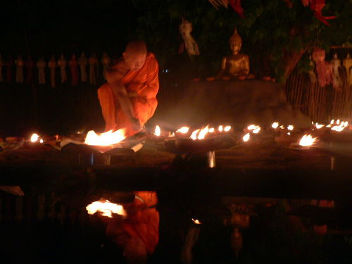 monk lighting candles