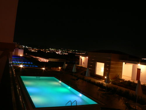 photo of pools lit at night